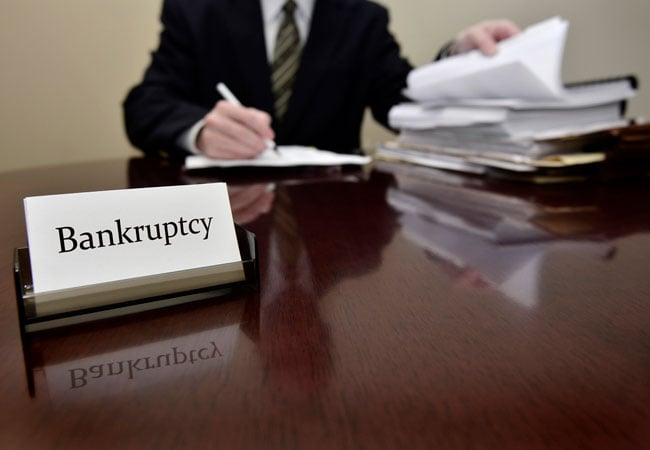 bankruptcy lawyer going over paperwork